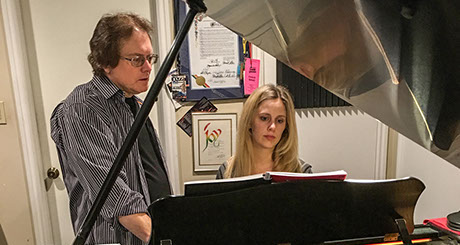 Bill Keis instructing a student on piano.